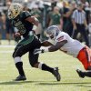Baylor\'s Lache Seastrunk (25) breaks away from Oklahoma State\'s Shaun Lewis (11) during a college football game between the Oklahoma State University Cowboys (OSU) and the Baylor University Bears at Floyd Casey Stadium in Waco, Texas, Saturday, Dec. 1, 2012. Photo by Nate Billings, The Oklahoman