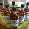 Photo -  Bottles of Scissortail bourbon atop a barrel. Photo provided by Scissortail Distillery  <strong></strong>