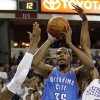 Oklahoma City Thunder forward Kevin Durant (35) shoots between Sacramento Kings\' DeMarcus Cousins (15) and Travis Outlaw during the first quarter of an NBA basketball game in Sacramento, Calif., Friday, April 20, 2012. (AP Photo/Rich Pedroncelli) ORG XMIT: SCA103