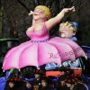 A carnival float depicting German Chancellor Angela Merkel wearing an umbrella skirt symbolizing the Europen bailout fund (in German Rettungsschirm) during the traditional carnival parade in Duesseldorf, western Germany, on Monday, Feb. 20, 2012. The foolish street spectacles in the carnival centers of Duesseldorf, Mainz and Cologne, watched by hundreds of thousands of people, are the highlights in Germany\'s carnival season on Rosemonday. (AP Photo/Frank Augstein) ORG XMIT: FAS113