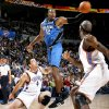 Orlando\'s Dwight Howard tries for a rebound between Oklahoma City\'s Nick Collison, left, and Joe Smith during the NBA basketball game between the Oklahoma City Thunder and the Orlando Magic at the Ford Center in Oklahoma City, Wednesday, Nov. 12, 2008. BY BRYAN TERRY, THE OKLAHOMAN