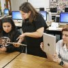Teacher Melissa Rangel, center, works with seniors Marissa Santiago and Wheatley Crawley on iPads in the multimedia and image management class at Putnam City High School. Photo BY PAUL B. SOUTHERLAND, THE OKLAHOMAN Archives