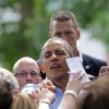 President Barack Obama makes his way through the crowd after he held a town hall meeting at Minnehaha Park ,Thursday, June 26, 2014, in Minneapolis. Obama said that Washington needs to stop