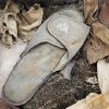 FILE - This file photo of June 19, 2011 shows an American Airlines slipper stored in Hangar 17 at John F. Kennedy International Airport in New York. The slipper is an artifact from the Sept. 11, 2001 attacks that is to be part of the National September 11 Memorial Museum, which will be dedicated Thursday, May 15, 2014, in a ceremony attended by President Barack Obama. It will open to the public May 21. (AP Photo/Mark Lennihan, File)