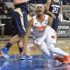 Photo - Syracuse' Brittney Sykes goes down with a knee injury during the second half of a first-round game in the NCAA college basketball tournament in Lexington, Ky., Saturday, March 22, 2014. Syracuse defeated Chattanooga 59-53. (AP Photo/Timothy D. Easley)