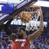 Miami Heat\'s LeBron James (6) dunks against the Utah Jazz in the second quarter of an NBA basketball game Saturday, Feb. 8, 2014, in Salt Lake City. (AP Photo/Rick Bowmer)