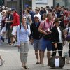 Photo - Members of the public wait to enter the grounds on the first day of the All England Lawn Tennis Championships in Wimbledon, London, Monday June 23, 2014. (AP Photo/Sang Tan)