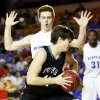 Bishop McGuinness\' David Love works against Tulsa Memorial\'s Grant Murphy (32) during the Class 5A boys championship high school basketball game in the state tournament at the Mabee Center in Tulsa, Okla., Saturday, March 9, 2013. Photo by Nate Billings, The Oklahoman