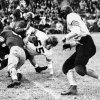 Oklahoma A&M University running back Bob Fenimore is stopped by OU\'s Homer Sparkman (back to camera) and Bob Mayfield during the Aggie\'s 28-6 victory over the University of Oklahoma Sooners at Taft Stadium. Staff photo taken Nov. 25, 1944.