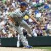 Photo - Los Angeles Dodgers starting pitcher Clayton Kershaw works against the Colorado Rockies in the first inning of a baseball game in Denver on Monday, Sept. 2, 2013. (AP Photo/David Zalubowski)