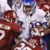 OU\'s Corey Nelson (7) and Frank Shannon (20) bring down KU\'s James Sims (29) during the college football game between the University of Oklahoma Sooners (OU) and the Kansas Jayhawks (KU) at Gaylord Family-Oklahoma Memorial Stadium in Norman, Okla., Saturday, Oct. 20, 2012. Photo by Bryan Terry, The Oklahoman