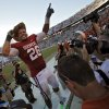 Oklahoma\'s Travis Lewis (28) salutes the fans while wearing the golden hat trophy after the Sooners\' 28-20 win over Texas in the Red River Rivalry college football game between the University of Oklahoma Sooners (OU) and the University of Texas Longhorns (UT) at the Cotton Bowl on Saturday, Oct. 2, 2010, in Dallas, Texas. Photo by Chris Landsberger, The Oklahoman