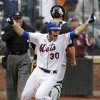 New York Mets\' Josh Thole celebrates after scoring the winning run on a single hit by Kirk Nieuwenhuis during the ninth inning of a baseball game against the Miami Marlins, Thursday, April 26, 2012, at Citi Field in New York. The Mets won 3-2. (AP Photo/Seth Wenig)