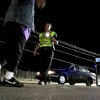 Deputy Sheriff Sean Shelby conducts a field sobriety test at a DUI checkpoint at NE 10th and Sooner, in Oklahoma County, operated by the Oklahoma County Sheriff\'s department , March 17, 2009. THE OKLAHOMAN ARCHIVES