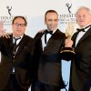 Producer Claude Chelli, left, and writer Abdul Raouf Dafri, center, celebrate winning an International Emmy for Drama Series for