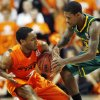 OSU\'s Brian Williams (4) and Baylor\'s A.J. Walton (22) try to control a loose ball in the first half of a men\'s college basketball game between the Oklahoma State University Cowboys and the Baylor University Bears at Gallagher-Iba Arena in Stillwater, Okla., Saturday, Feb. 4, 2012. Photo by Nate Billings, The Oklahoman