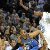 Oklahoma City Thunder guard Russell Westbrook (0) drives past Denver Nuggets center Nene (31) from Brazil during the first half of game 3 of a first-round NBA basketball playoff series Saturday, April 23, 2011, in Denver. (AP Photo/Jack Dempsey)