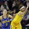 UCLA\'s Kari Korver (2) defends as California\'s Layshia Clarendon tries to control the ball in the first half of an NCAA college basketball game in the Pac-12 Conference tournament Saturday, March 9, 2013, in Seattle. (AP Photo/Elaine Thompson)