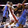 Miami\'s Mario Chalmers (15) goes to the basket between Oklahoma City\'s Russell Westbrook (0) and Oklahoma City\'s Serge Ibaka (9) during Game 4 of the NBA Finals between the Oklahoma City Thunder and the Miami Heat at American Airlines Arena, Tuesday, June 19, 2012. Oklahoma City lost 104-98. Photo by Bryan Terry, The Oklahoman