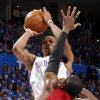 Oklahoma City\'s Russell Westbrook (0) shoots the ball over Miami\'s Dwyane Wade (3) during Game 1 of the NBA Finals between the Oklahoma City Thunder and the Miami Heat at Chesapeake Energy Arena in Oklahoma City, Tuesday, June 12, 2012. Photo by Chris Landsberger, The Oklahoman