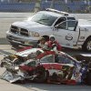 Photo -   Mike Harmon climbs out of his car after being involved in a multi-car wreck during the International Motorsports Hall of Fame 250 ARCA auto race at the Talladega Superspeedway in Talladega, Ala., Friday, May 4, 2012. (AP Photo/Rainier Ehrhardt)