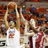 Oklahoma State\'s Brittney Martin (22) grabs a rebound next to teammate Liz Donohoe (4), who is caught between Oklahoma\'s Joanna McFarland (53) and Sharane Campbell (24), during the Bedlam women\'s college basketball game between Oklahoma State University (OSU) and the University of Oklahoma (OU) at Gallagher-Iba Arena in Stillwater, Okla., Saturday, Feb. 23, 2013. Photo by Nate Billings, The Oklahoman