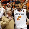 Boone Pickens talks to Oklahoma State\'s Le\'Bryan Nash (2) during the singing of the alma mater after a men\'s college basketball game between Oklahoma State University (OSU) and the University of Texas at Gallagher-Iba Arena in Stillwater, Okla., Saturday, March 2, 2013. OSU won, 78-65. Photo by Nate Billings, The Oklahoman