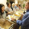 Volunteers Jessica Lau, left and Jeff Goodwin fill plates for guest at the Edmond Community Thanksgiving event at The University of Central Oklahoma in Edmond, Thursday November 22, 2012. Photo By Steve Gooch, The Oklahoman