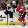 Ottawa Senator\'s Chris Neil (25) and Boston Bruins\' Aaron Johnson (45) battle along the board for the puck during the first period of an NHL hockey game in Ottawa Thursday March 21, 2013.(AP Photo/The Canadian Press, Fred Chartrand)