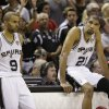 San Antonio Spurs\' Tony Parker (9) and Tim Duncan (21) wait on the sideline against the Miami Heat during the first half at Game 4 of the NBA Finals basketball series, Thursday, June 13, 2013, in San Antonio. (AP Photo/Eric Gay)