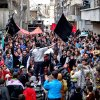 Photo - This citizen journalism image provided by Aleppo Media Center AMC which has been authenticated based on its contents and other AP reporting, shows anti-Syrian regime protesters holding banners and chanting slogans, during a demonstration in the neighborhood of Bustan Al-Qasr in Aleppo, Syria, Friday, March. 1, 2013. Syrian government forces fought fierce clashes with rebels attacking a police academy near the northern city of Aleppo on Friday, while the bodies of 10 men most of them shot in the head were found dumped along the side of a road outside Damascus, activists said. (AP Photo/Aleppo Media Center AMC)
