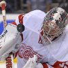 Photo - Detroit Red Wings goalie Jimmy Howard stops a shot during the second period of an NHL hockey game against the Los Angeles Kings, Saturday, Jan. 11, 2014, in Los Angeles. (AP Photo/Mark J. Terrill)