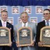 Photo - National Baseball Hall of Fame inductees Tom Glavine, left, Bobby Cox and Greg Maddux, right, hold their plaques after an induction ceremony at the Clark Sports Center on Sunday, July 27, 2014, in Cooperstown, N.Y. (AP Photo/Mike Groll)