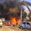 This photo released by the Syrian official news agency SANA, shows flames and smoke rising from burned cars after a huge explosion that shook central Damascus, Syria, Thursday, Feb. 21, 2013. A car bomb shook central Damascus on Thursday, exploding near the headquarters of the ruling Baath party and the Russian Embassy, eyewitnesses and opposition activists said. (AP Photo/SANA)