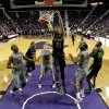 Photo - Baylor's Isaiah Austin (21) dunks during the first half of an NCAA college basketball game against Kansas State Saturday, March 8, 2014, in Manhattan, Kan. (AP Photo/Charlie Riedel)