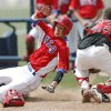 Silo\'s Andrew Bolin slides past Caney Valley\'s Caleb Pease to score in the third inning of a Class 2A state baseball tournament game in Shawnee, Okla., Friday, May 10, 2013. Photo by Bryan Terry, The Oklahoman
