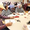 Don Moberly, Carmel Hart, Becky Tilley and Pearl Fitzgibbon, from left, dressed in their best Halloween gear to play trick-or-treat bingo at the Edmond Senior Center. PHOTOS BY DAVID MCDANIEL, THE OKLAHOMAN