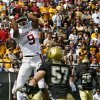 Oklahoma\'s Juaquin Iglesias (9) pulls in a touchdown over Colorado\'s Jake Duren (57) during the first half of the college football game between the University of Oklahoma Sooners (OU) and the University of Colorado Buffaloes (CU) at Folsom Field on Saturday, Sept. 28, 2007, in Boulder, Co. By Bryan Terry, The Oklahoman