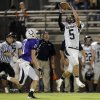 Photo - Perkins' Matt Waitt makes a catch in front of Bethany's Zech Kalfas during the high school football game between Bethany High School and Perkins in Bethany, Okla., Friday, Sept. 28, 2012.  Photo by Sarah Phipps, The Oklahoman