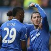 Photo - Chelsea's Eden Hazard, right, celebrates after scoring the opening goal and points towards teammate Samuel Eto'o who provided the assist during their English Premier League soccer match between Chelsea and Newcastle United in London Saturday, Feb 8  2014. (AP Photo/Alastair Grant)