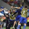 Photo - Italian goalie Gianluigi Buffon, face to camera, and coach Cesare Prandelli, center, celebrate with the team after the group D World Cup soccer match between England and Italy at the Arena da Amazonia in Manaus, Brazil, Saturday, June 14, 2014. Italy won the match 2-1. (AP Photo/Fabio Ferrari)