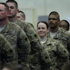 A returning soldier smiles at her family during the return ceremony for the National Guard\'s 45th Infantry Brigade Combat Team at the Army Aviation hanger at Will Rogers Air National Guard Base Sunday, March 25th, 2012. PHOTO BY HUGH SCOTT, FOR THE OKLAHOMAN