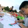 Benjamin Nguyen, 8, colors during the Children\'s Asian Moon Festival on the University of Central Oklahoma campus, in Edmond, Okla., Friday, Sept. 12, 2008 BY MATT STRASEN, THE OKLAHOMAN.