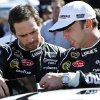 Jimmie Johnson, left, talks with crew chief Chad Knaus prior to the NASCAR Sprint Cup Series auto race at Phoenix International Raceway Sunday, Nov. 11, 2012, in Avondale, Ariz. (AP Photo/Ross D. Franklin)