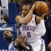 Oklahoma City\'s Russell Westbrook (0) is fouled by Memphis\' Tony Allen (9) during Game 7 in the first round of the NBA playoffs between the Oklahoma City Thunder and the Memphis Grizzlies at Chesapeake Energy Arena in Oklahoma City, Saturday, May 3, 2014. Photo by Nate Billings, The Oklahoman