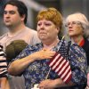 Fighting back tears, a woman in the crowd becomes emotional during the playing of the national anthem at the beginning of the ceremony. . When 84 Oklahoma Army National Guard troops marched into the hangar at the Air National Guard base in southwest Oklahoma City Saturday morning, April 7, 2012, about 350 people, mostly family and friends, gave them a rousing and enthusiastic welcome. Their homecoming celebration marked the final return of soldiers with the 45th who had been deployed to Iraq and Afghanistan. Photo by Jim Beckel, The Oklahoman