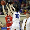 Erick\'s Heidi Brinkley looks to pass the ball as Lomega\'s KylieTurner defend during the Class B girls state championship between Erick and Lomega at the State Fair Arena., Saturday, March 2, 2013. Photo by Sarah Phipps, The Oklahoman
