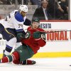 Photo - St. Louis Blues right wing Ryan Reaves (75) hits Minnesota Wild center Mikael Granlund (64) during the first period of their NHL hockey game Sunday, March 9, 2014 in St. Paul, Minn..(AP Photo/Andy Clayton-King)