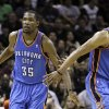 Photo -   Oklahoma City Thunder small forward Kevin Durant (35) and Russell Westbrook (0) react against the San Antonio Spurs during the first half of Game 1 in their NBA basketball Western Conference finals playoff series on Sunday, May 27, 2012, in San Antonio. (AP Photo/Eric Gay)
