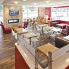 Photo -   This photo provided by Wendy's Co. on March 1, 2012, photo, shows the interior of a remodeled restaurant. Wendy's push to remake itself as a higher-end hamburger chain is starting to pay off, with a key sales figure rising for the sixth straight quarter. The company, based in Dublin, Ohio, is trying to pull away from the image of the typical fast-food chain and cast itself as a purveyor of higher-quality burgers and sides. The move reflects the growing popularity of chains such as Chipotle and Panera, which offer better quality food for slightly higher prices. (AP Photo/Wendy's Co.)